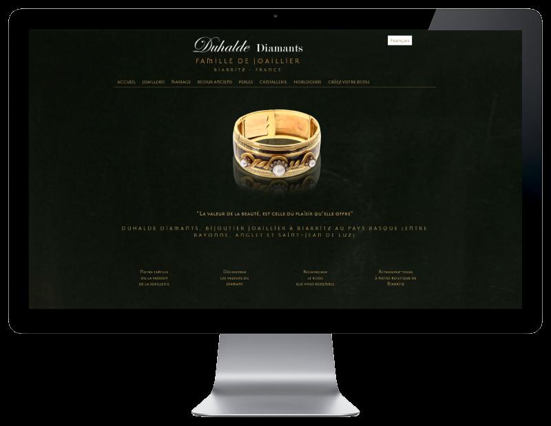 L'agence web REZO 21 d'anglet développe le catalogue en ligne de Duhalde Diamants Biarritz sur grand écran