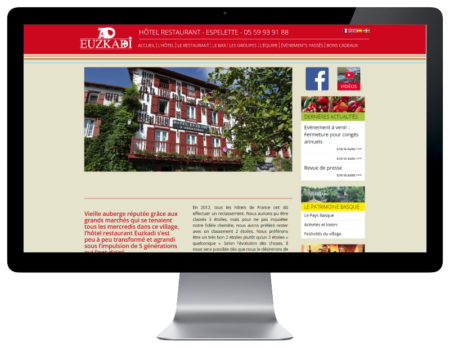 REZO 21, création de sites Internet réalise le nouveau site Internet de l'Hotel restaurant euskadi à Espelette Pays basque, vue sur grand écran