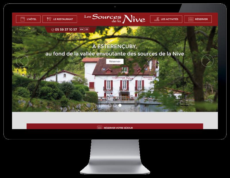 Site Internet de l'hôtel les sources de la nive au pays basque réalisé par l'agence web rezo 21 vue sur grand écran