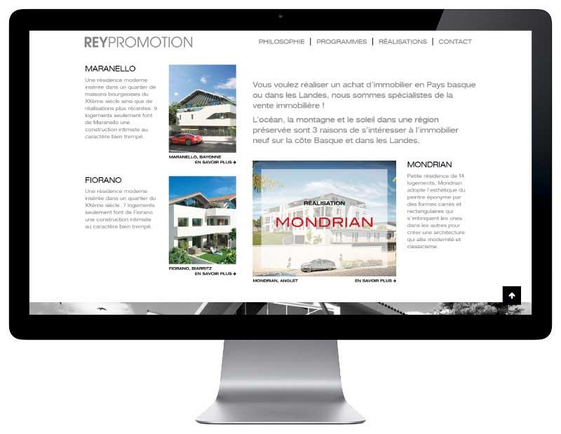 Le promoteur REY IMMOBILIER confie la refonte de son site Internet à l'agence web REZO 21 Pays Basque vue sur grand écran