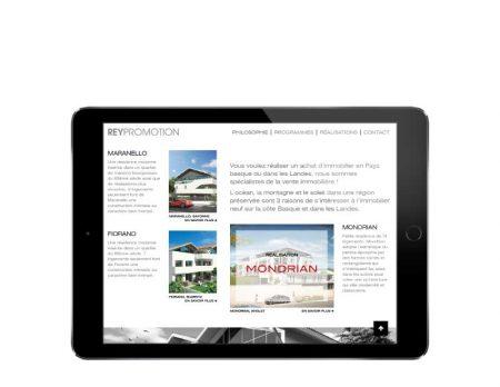 Le promoteur REY IMMOBILIER confie la refonte de son site Internet à l'agence web REZO 21 Pays Basque vue sur tablette